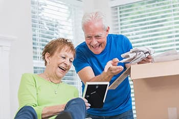 Couple packing and laughing